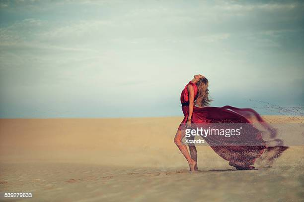Woman dissapearing in the desert