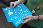 A woman distributes leaflets on the 'Global Day of Action On Military Spending' criticising the amount of Government defense spending on April 15...