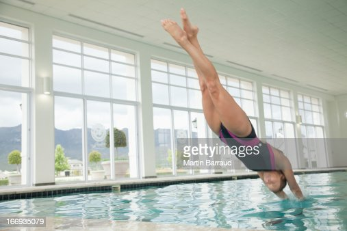 Woman Diving In Swimming Pool Stock Photo Getty Images