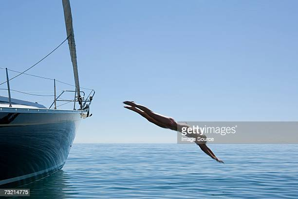 Woman diving into ocean