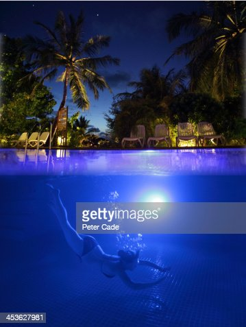 Woman Diving Into Swimming Pool At Night Stock Photo Getty Images