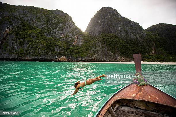 A woman diving into tropical water.