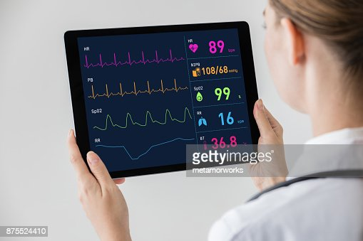 Woman doctor watching vital sign with tablet PC. : Stock Photo