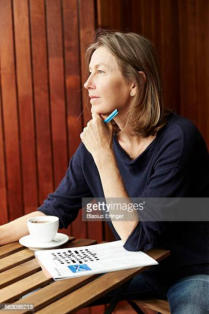 Woman does crossword