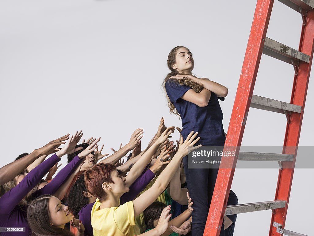 Woman Does Trust Fall with a Diverse Group