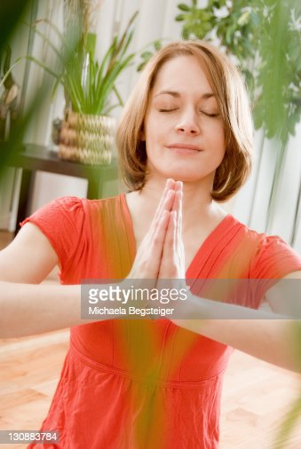 Woman does yoga at home
