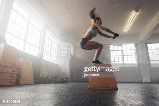 Woman doing a box squat at the gym : Stock-Foto