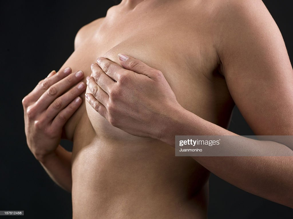 woman doing a self check breast exam : Stock Photo