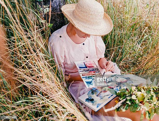 Woman doing a watercolour painting outdoor