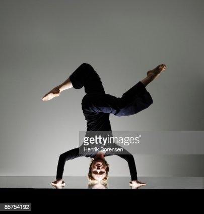 Woman doing a yoga headstand. : Stock Photo