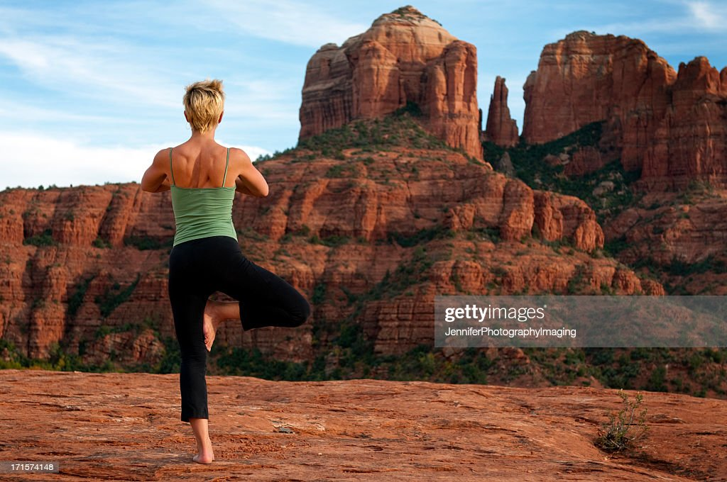A woman doing a yoga pose in a desert environment