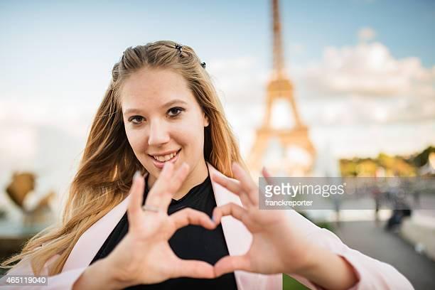 woman doing an heart shape