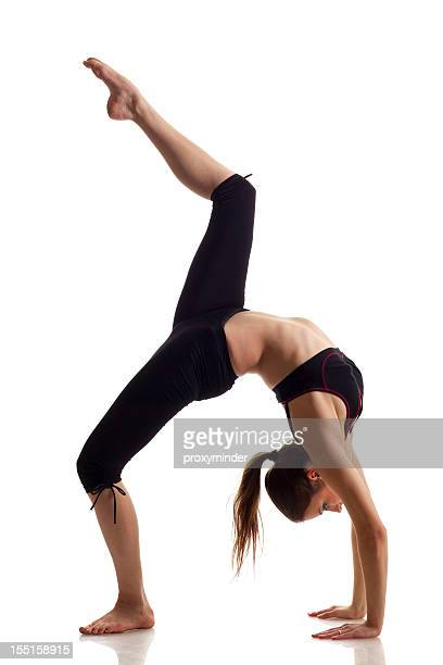 Woman doing back-bend with knee raised
