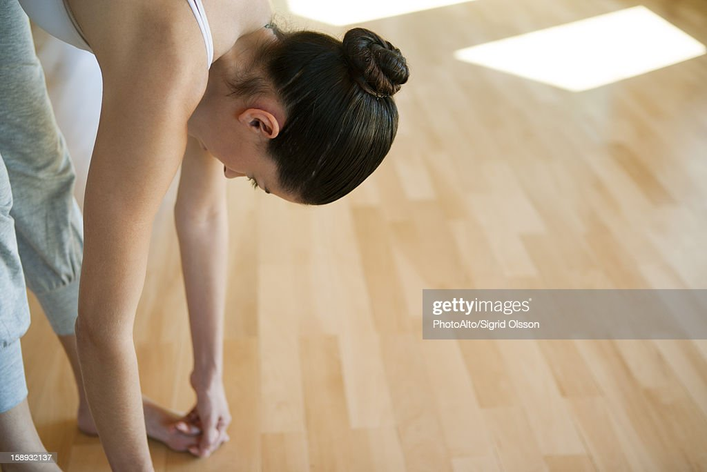 Woman doing big toe pose