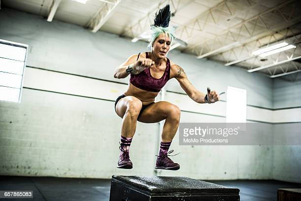 Woman doing box jumps at crossfire gym