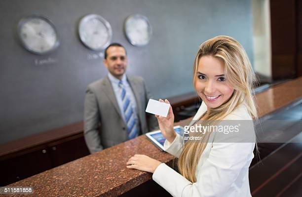 Woman doing check in at a hotel
