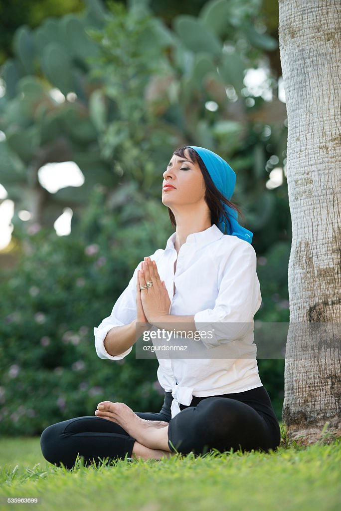 Woman doing exercise : Stock Photo