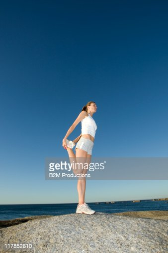 Woman doing exercises outdoor : Stock Photo