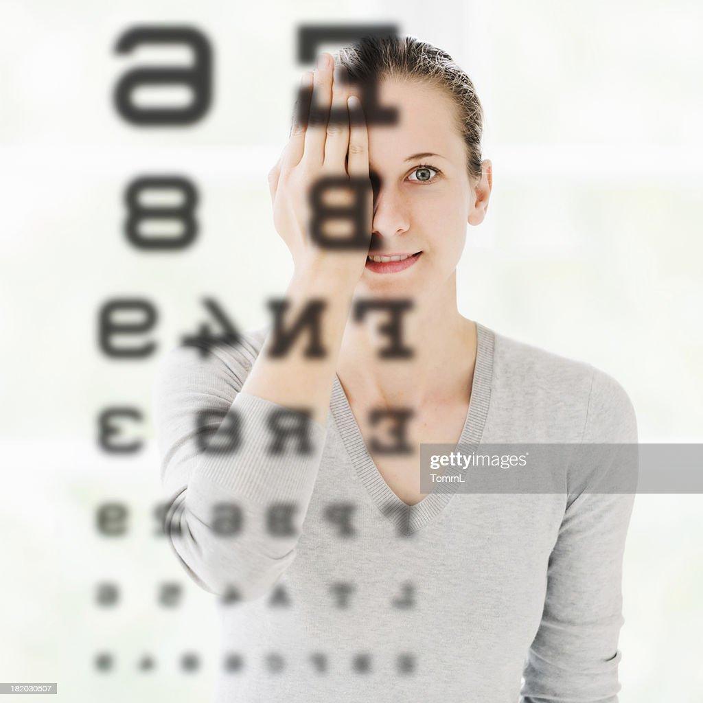 Woman Doing Eye Exam at Optometrist