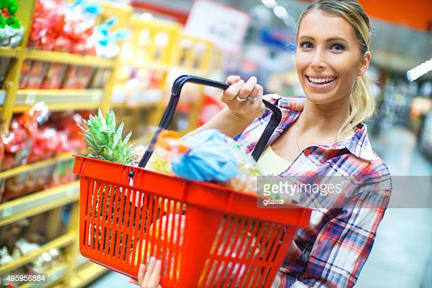 Woman doing grocery shooping in supermarket.