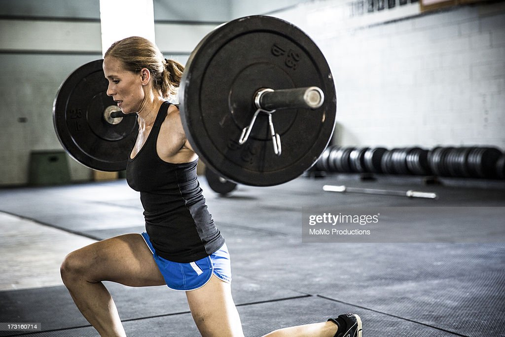 woman doing gym lunges : Stock Photo