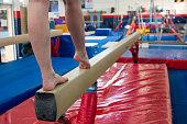 Gymnast doing beam training