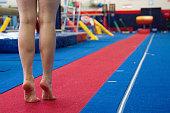 Gymnast preparing to do vault training