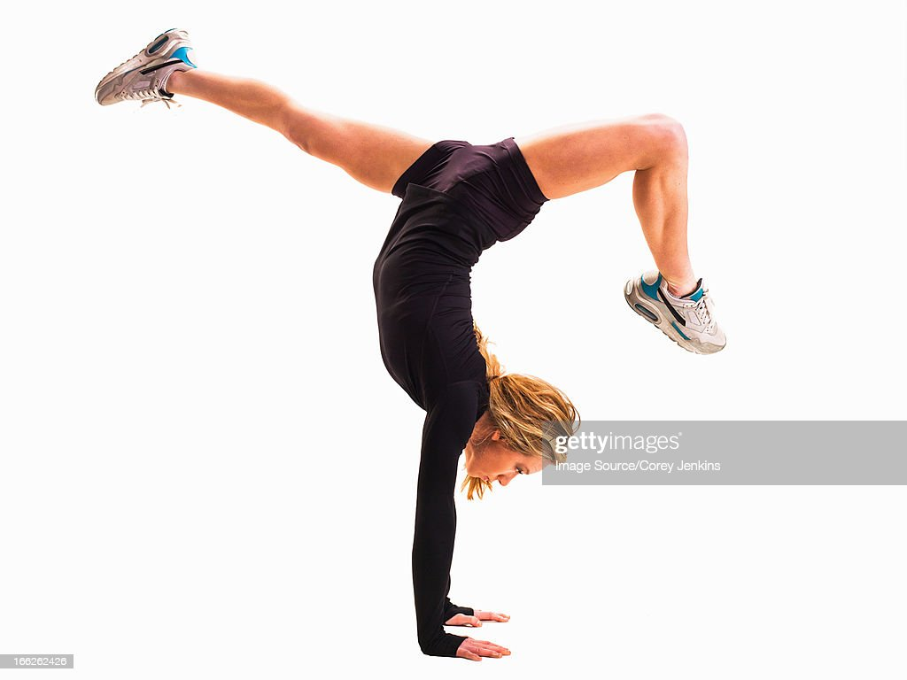 Woman doing handstand : Stock Photo