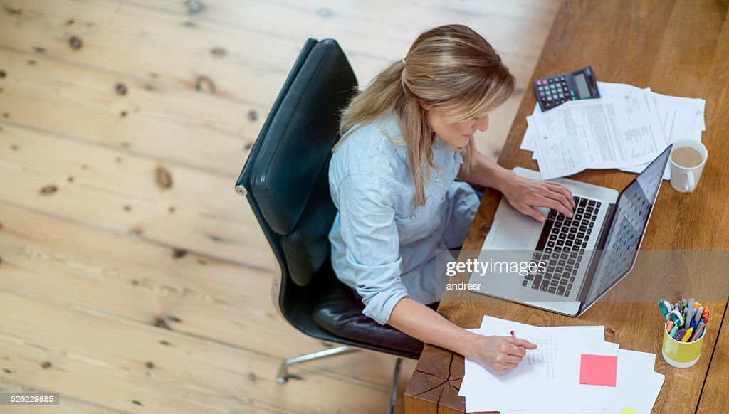Woman doing her home finances