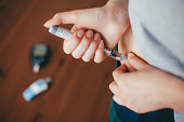 woman doing injection with insulin pen