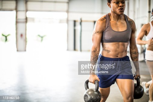 woman doing kettle bell carry/Gym : Stock Photo