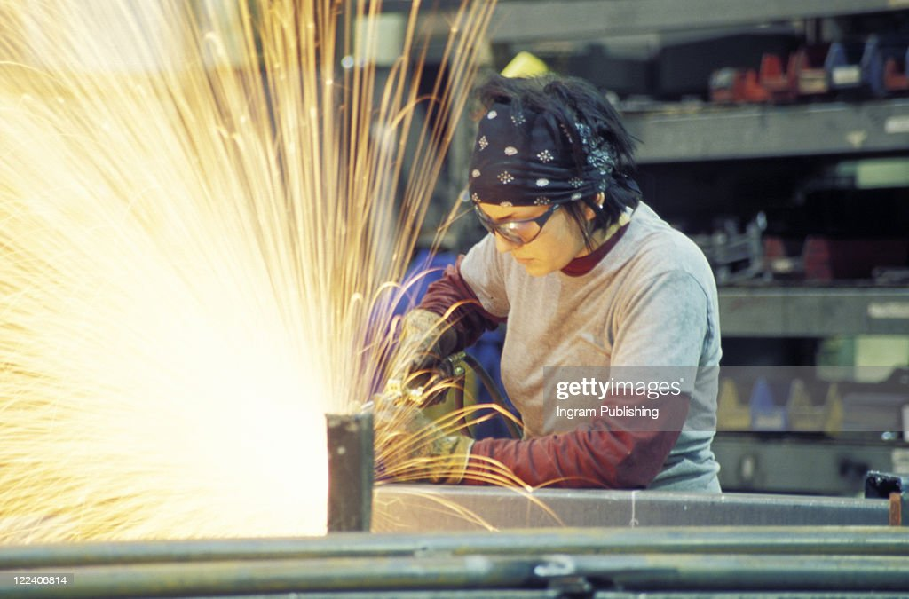 Woman doing metal work