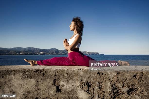 Woman doing monkey yoga pose