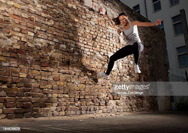 Woman doing Parkour Tic-Tac