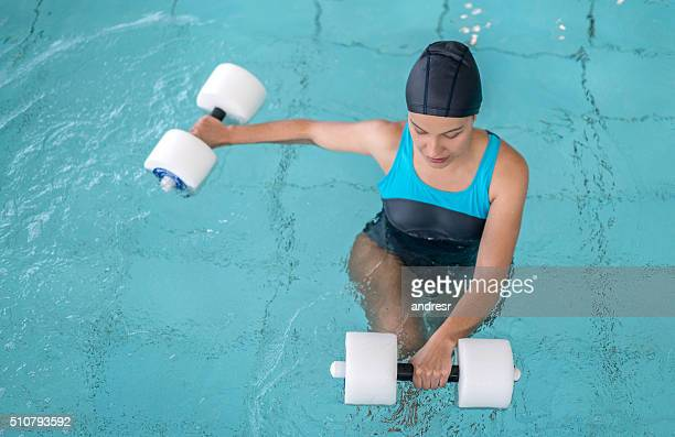 Woman doing physiotherapy exercises in the water