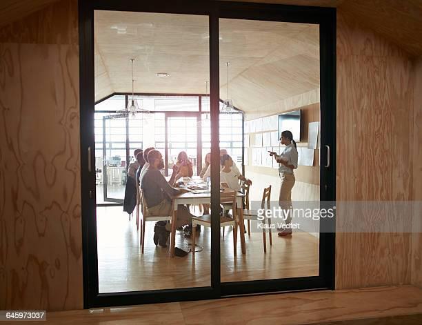 Woman doing presentation in modern meeting room