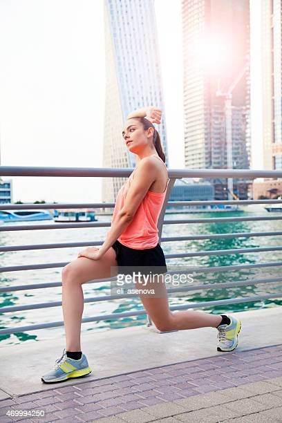 Woman Doing Relaxation Exercise in Dubai Marina.