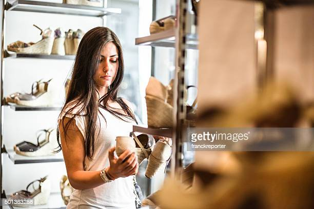 woman doing shopping in a shoes store