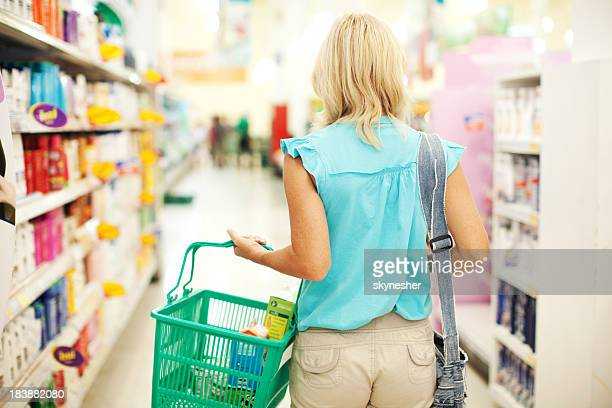 Woman doing shopping of toiletry in the store.