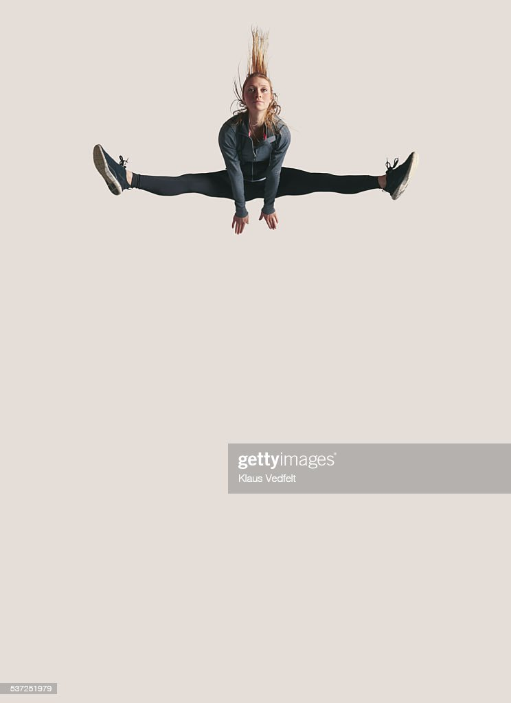 Woman doing split in the air