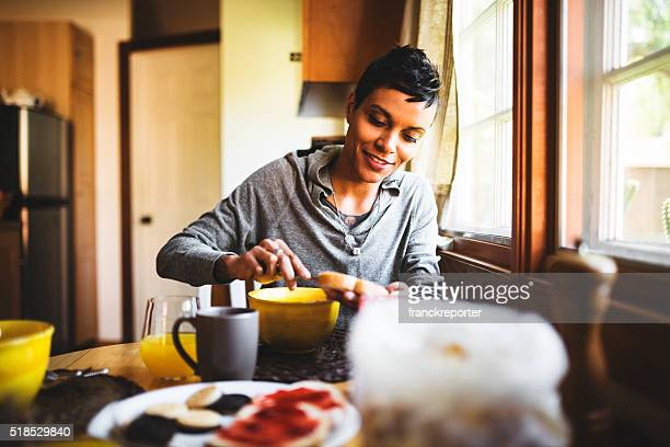 woman doing the breakfast in the kitchen