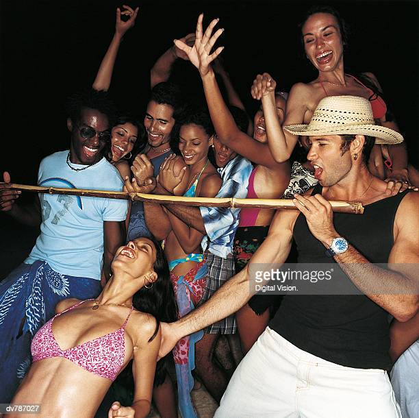 Woman Doing the Limbo at a Crowded Party