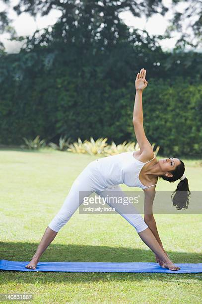Woman doing Trikonasana (Triangle Position)