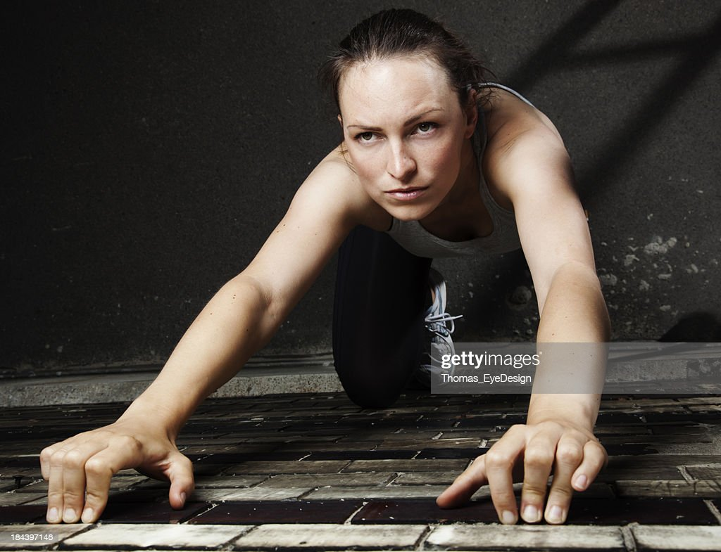 Woman doing Wall Run Parkour move
