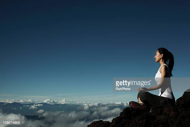 woman doing yoga at the mountain