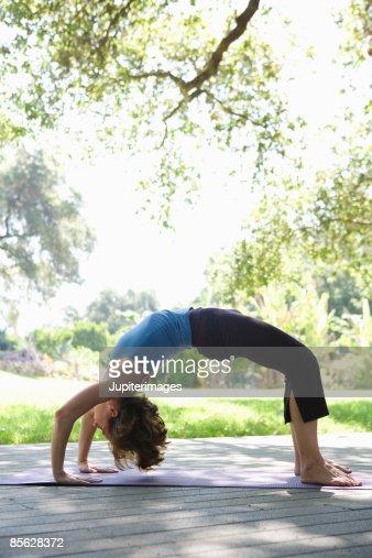 Woman doing yoga backbend