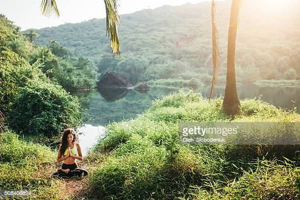 Woman doing yoga in jungles