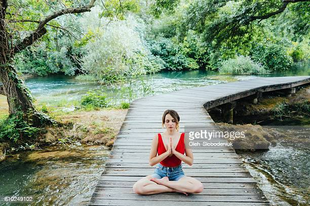 Woman doing yoga in Krka National Park