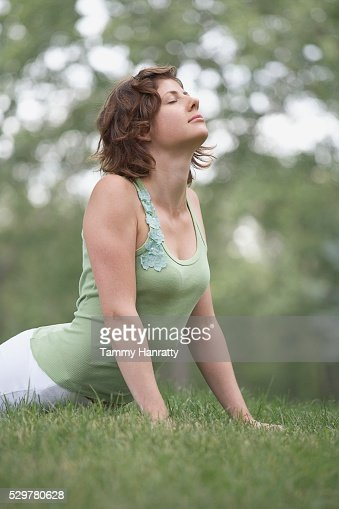 Woman doing yoga in park : Stock-Foto