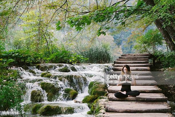 Woman doing yoga in Plitvice National park
